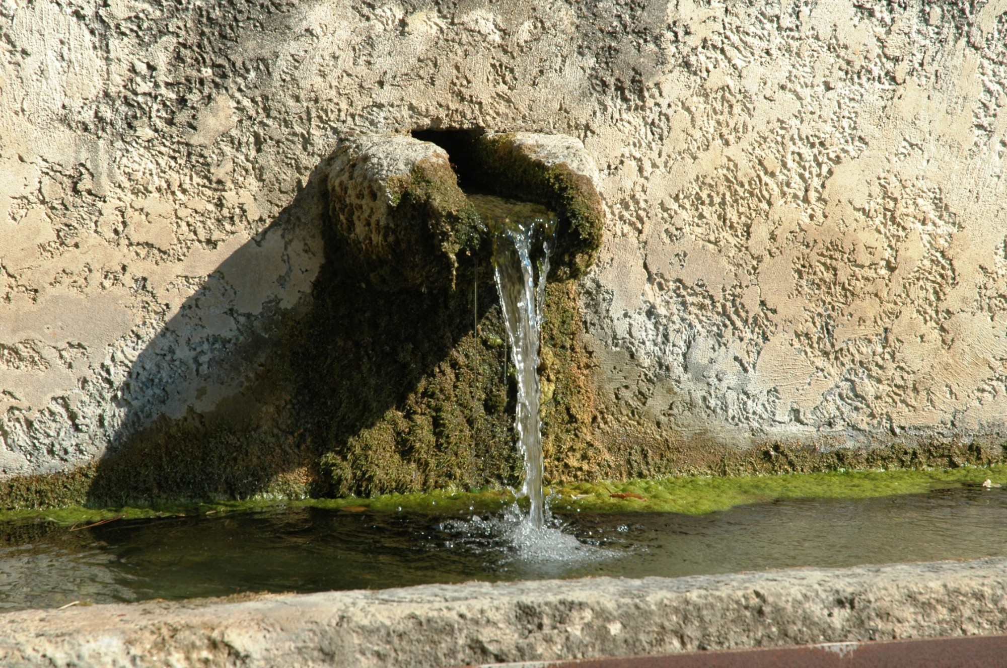 Some fountains are rustic, discreet, beautiful in their simplicity